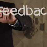 businessman hand writing Feedback with recycle paper